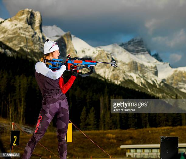 Biathlon athlete takes aim with competition rifle