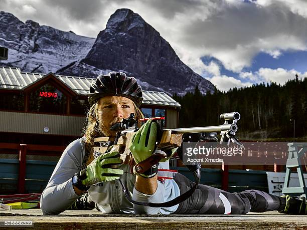 Biathlon athlete takes aim with competition rifle