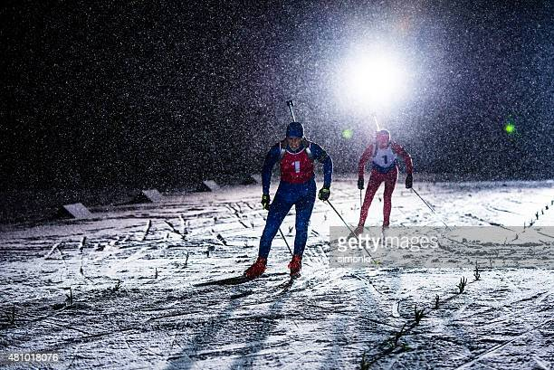 Biathlon athletes skiing