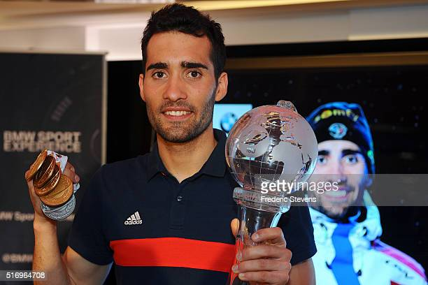 Biathlon Champion Martin Fourcade poses with his trophy as he gives a Press Conference at BMW Brand Store on March 22 2016 in Paris France Fourcade...
