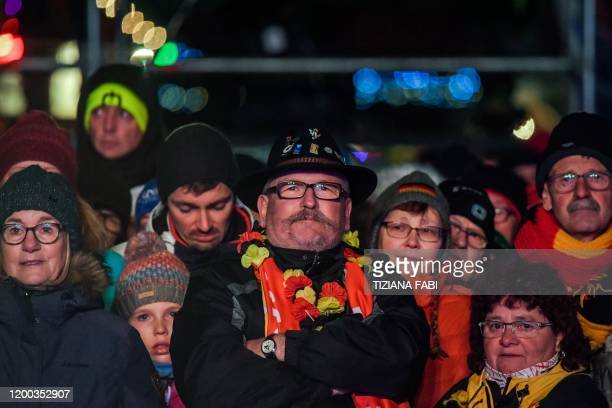 Biathlon enthusiasts attend a presentation ceremony on the eve of the 11-day IBU World Championships Biathlon in Rasen-Antholz , Italian Alps, on...