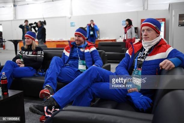 Biathlon mixed relay silver medallists Norway's Johannes Thingnes Boe and Emil Hegle Svendsen wait backstage at the Athletes' Lounge during the medal...