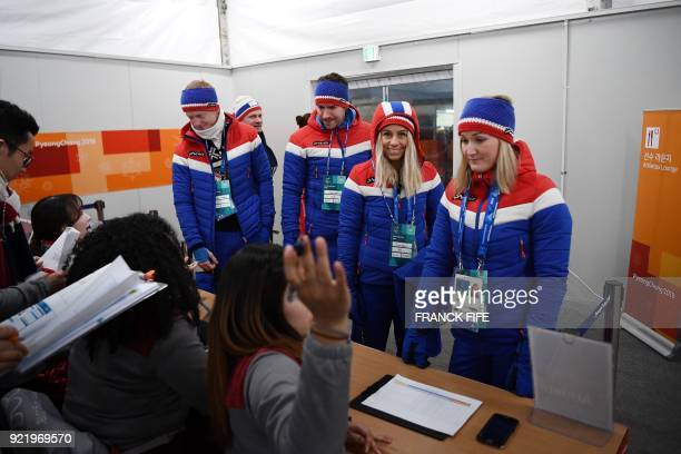 Biathlon mixed relay silver medallists Norway's Marte Olsbu Tiril Eckhoff Johannes Thingnes Boe and Emil Hegle Svendsen speak to crew members...