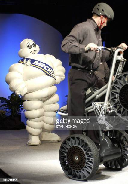 Bibendum the mascot for the French Michelin tire company watches a man demonstrating a devices equiped with the Michelin 'Tweel' 09 January 2005...
