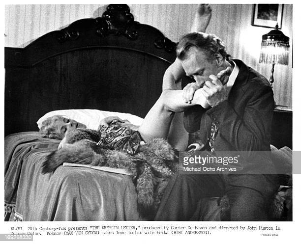 Bibi Andersson has her foot kissed by Max von Sydow in a scene from the film 'The Kremlin Letter' 1970