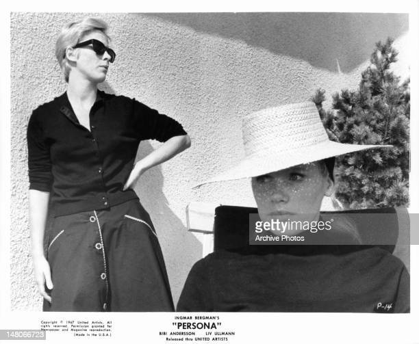 Bibi Andersson wearing sunglasses behind Liv Ullmann in a scene from the film 'Persona' 1966