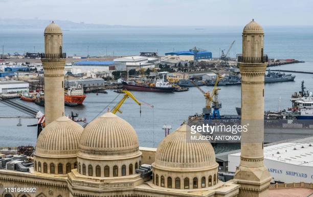 Bibi Heybat mosque is seen in front of Bibi Heybat Oil Field situated at the coast of the Caspian Sea outside Baku on March 19 2019 Bibi Heybat's...