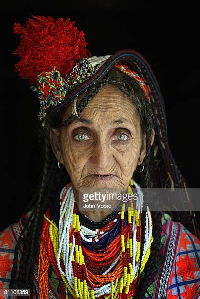 Bibi Kai age 65 of the polytheistic Kalash tribe stands in the doorway of her extended family home May 15 2008 in the remote Chitral village of...