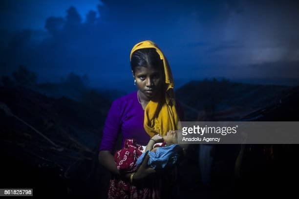 COX'S BAZAR BANGLADESH OCTOBER 11 Bibi Zeyna is seen with her 6 days baby with no given name at a makeshift camp in Cox's Bazar Bangladesh on October...