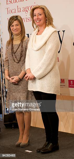 Bibiana Aido and Emma Thompson attends 'The Journey' exhibition in The Retiro park on December 11 2009 in Madrid Spain