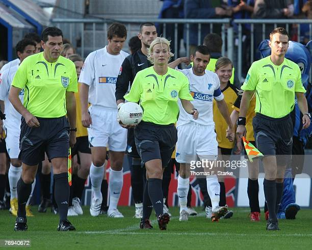 Bibiana Steinhaus walks onto the pitch surrounded by assitants Carsten Kadach and Marek Preuss ahead of the 2nd Bundesliga match between SC Paderborn...