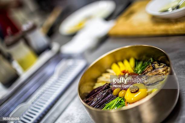 bibimbap freshly cooked - jeonju stock photos and pictures