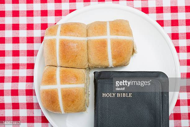 bible and hot cross buns - hot cross bun stock pictures, royalty-free photos & images