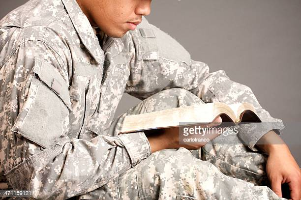 bible, military man - soldier praying stock photos and pictures