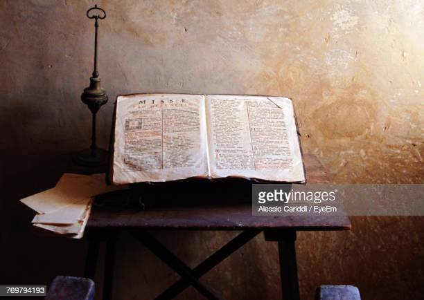 Bible On Table Against Wall