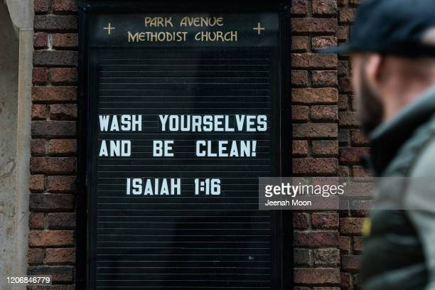 Bible phrase from the book of Isaiah adorns the outside of church on March 12, 2020 in New York City. The museum announced it will be closed Friday...