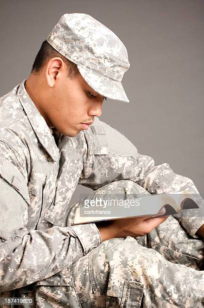 bible - military praying stock pictures, royalty-free photos & images