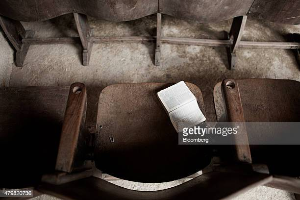 A bible sits in a pew of a church in the Dilma Rousseff favela of Rio de Janeiro Brazil on Monday July 6 2015 As the fastest inflation in more than a...