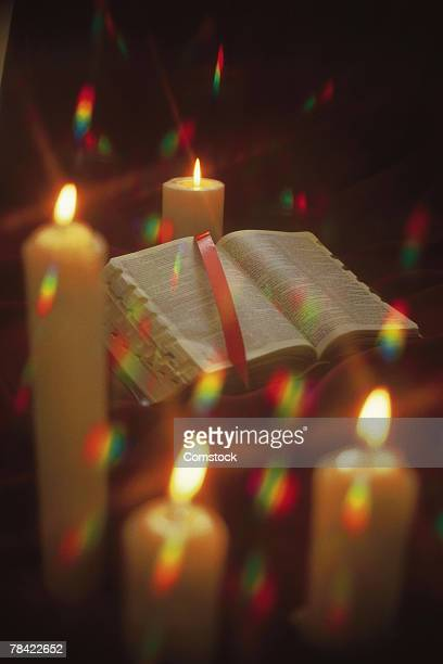 Bible surrounded by lit candles