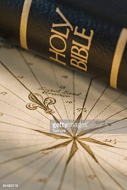 Bible with compass rose on map