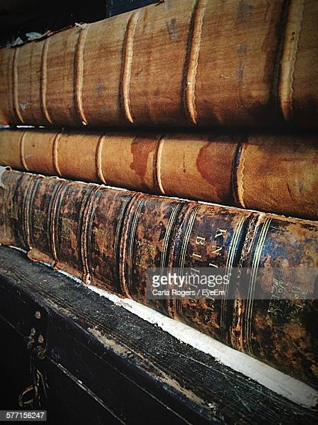 bibles on shelf in church - faith rogers stock pictures, royalty-free photos & images