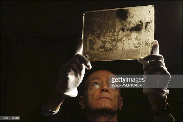 Biblical And Archaeological School Of Jerusalem On March 1 2004 In Jerusalem Israel Father JeanMichel Tarragon Director Of The Photo Library Examines...