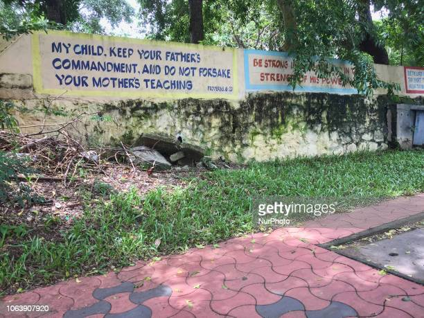 Biblical verses on a wall in the city of Thiruvananthapuram Kerala India