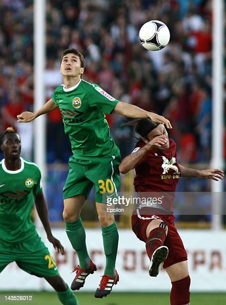 Bibras Natkho of FC Rubin Kazan battles for the ball with Marcos Pizzelli of FC Kuban Krasnodar during the Russian Football League Championship match...