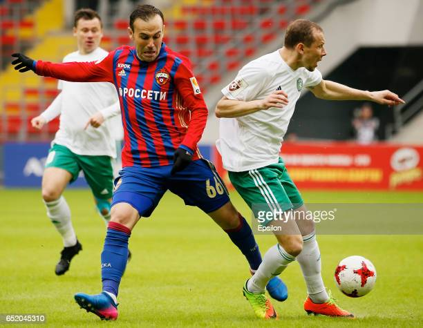 Bibras Natkho of PFC CSKA Moscow challenged by Pavel Golyshev of FC Tom Tomsk during the Russian Premier League match between PFC CSKA Moscow and FC...