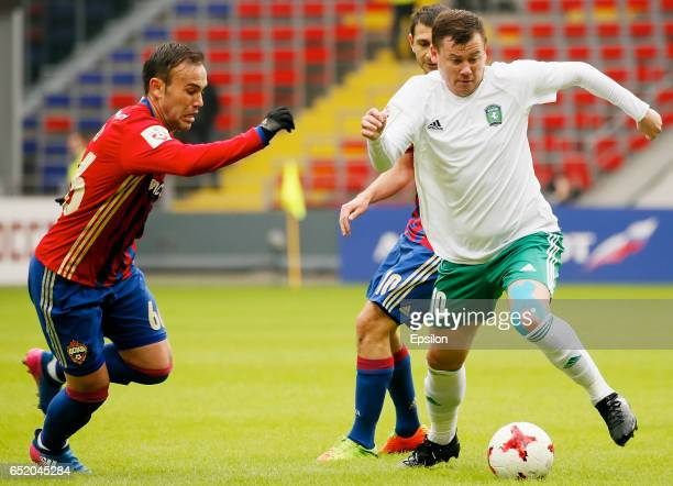 Bibras Natkho of PFC CSKA Moscow challenged by Sergey Kuznetsov of FC Tom Tomsk during the Russian Premier League match between PFC CSKA Moscow and...