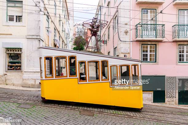 bica funcilar on the street of lisbon old town, portugal - lisbon stock pictures, royalty-free photos & images