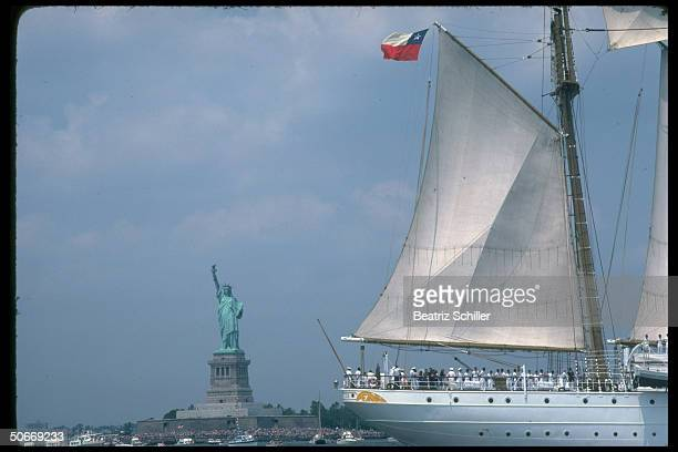 US Bicentennial Operation Sail vessel framed by State of Liberty