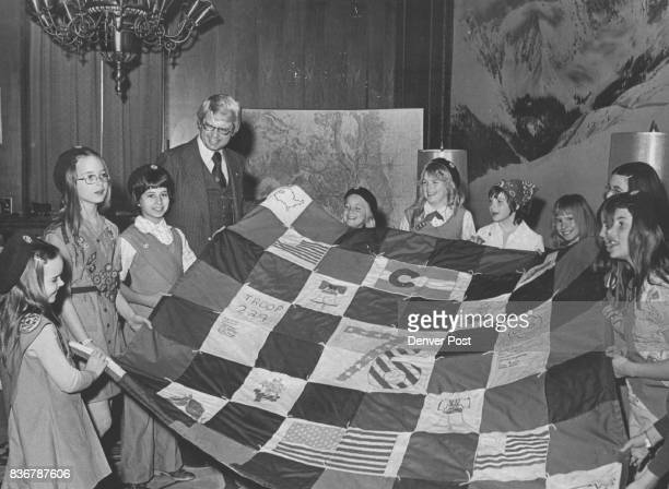 Bicentennial Quilt Presented To Governor Lamm by Junior Girl Scouts Troop 239 from Kinnikinnick neighborhood in Arvada made the squares and assembled...