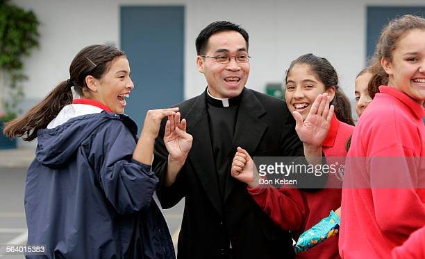 – –Bich Vu greets students on the campus of Holy Family Cathedral School. On Saturday, Vu will be one of three individuals ordained as Catholic...