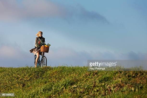 biciycle girl on dutch dike