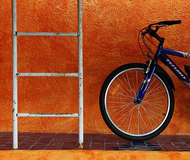 Bicycle Against Orange Wall