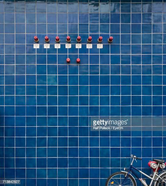 Bicycle Against Tiled Blue Wall