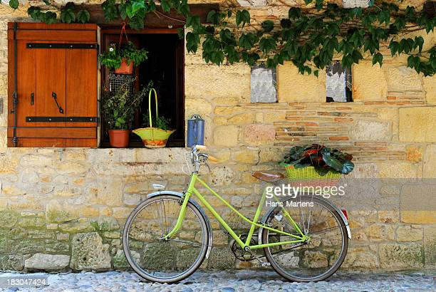 bicycle aginst the wall of a rustic house