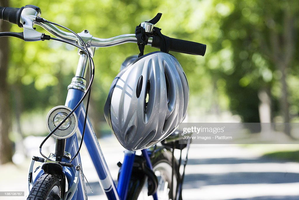 A bicycle and a safety helmet, Sweden. : Stock Photo