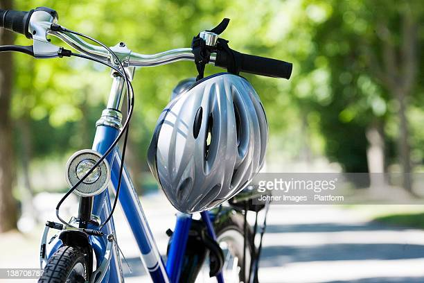 a bicycle and a safety helmet, sweden. - cycling helmet stock photos and pictures