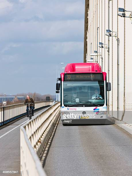 bicycle and bus on waalbrug - nijmegen stock pictures, royalty-free photos & images