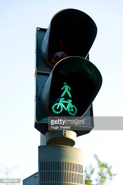 bicycle and pedestrian green light - hugh threlfall stock pictures, royalty-free photos & images
