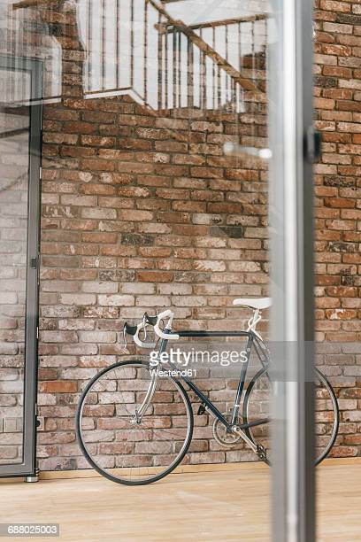 Bicycle at brick wall in office