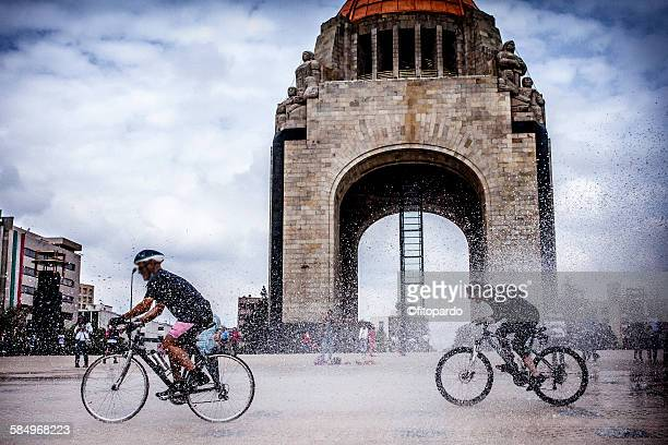 bicycle at monumento de la revolucionicycle monume - mexico city stock pictures, royalty-free photos & images