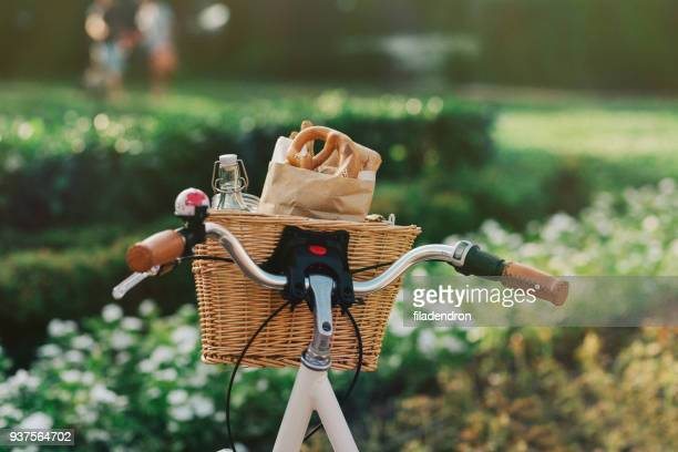 bicycle basket full of groceries - basket stock photos and pictures