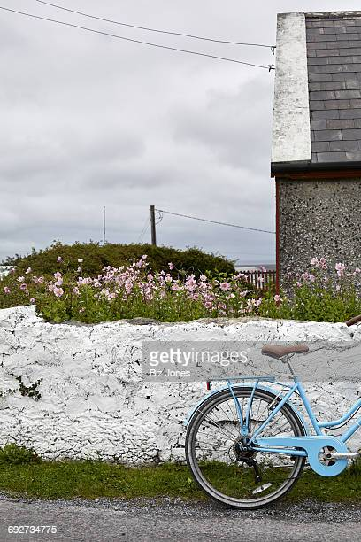 Bicycle beside wall, Inishmore, Ireland