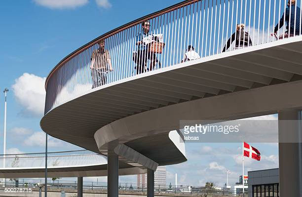 Bicycle bridge in Copenhagen, Denmark. Danish flag.