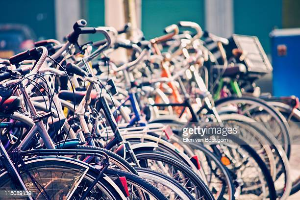 bicycle chaos - bicycle parking station stock photos and pictures