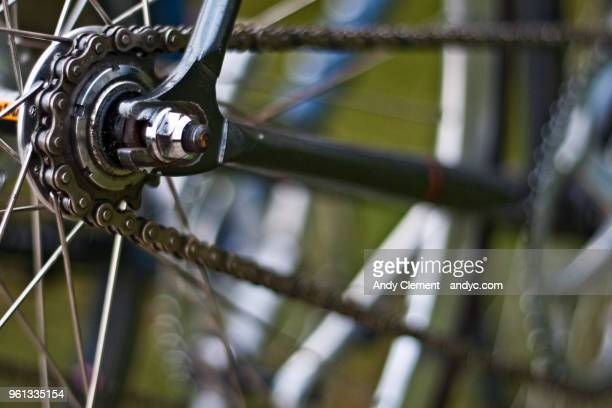 bicycle cog and chain - andy clement stock photos and pictures