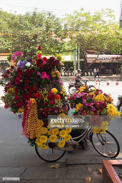 Bicycle covered in flowers for sale, Vietnam
